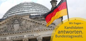 Reichstag in Berlin mit Deutschlandfahne - weiter zu unseren Infos über die Bundestagswahl
